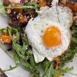 Plant-forward, paleo breakfast salad of roasted vegetables and rocket.
