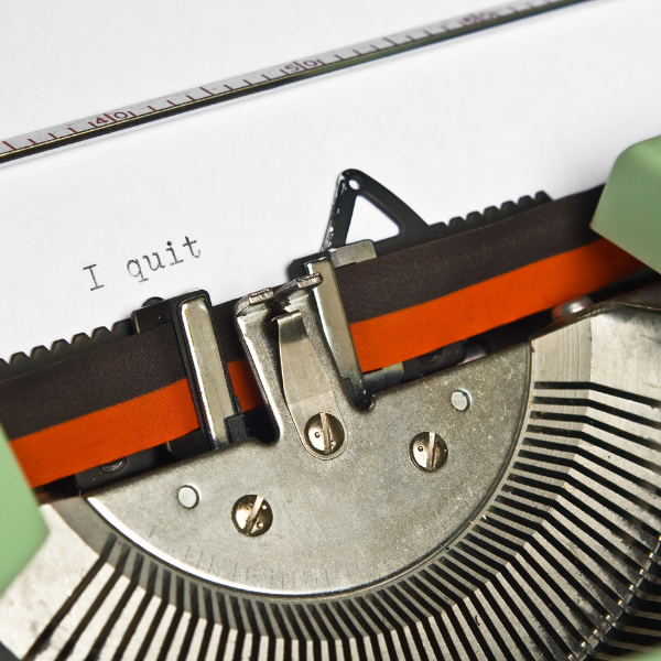 "close up of typewriter with the words ""I quit"" on the paper"