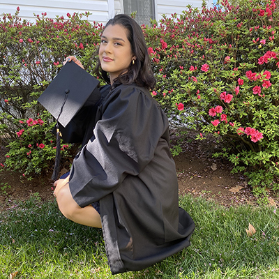 photo of caitlin in a graduation gown